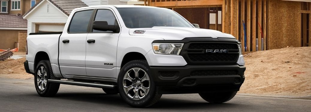 white 2021 Ram 1500 front fascia passenger side parked at work site