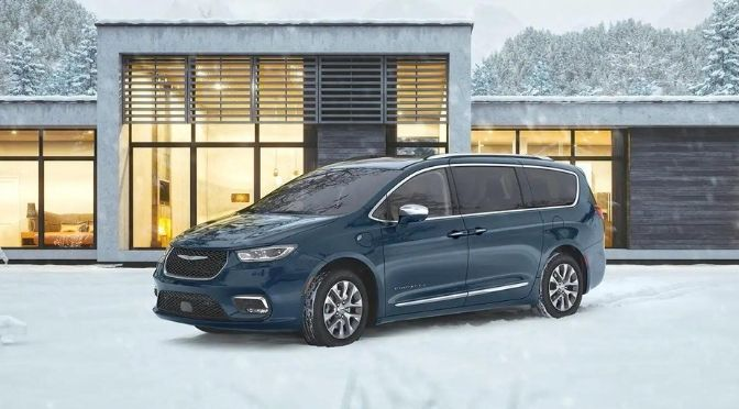 2021 Chrysler Pacifica Front Left-Quarter View Parked in Front of a House.