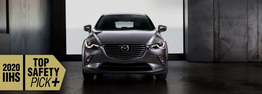 Front angle of a grey 2020 Mazda CX-3 with the IIHS Top Safety Pick+ logo