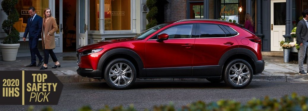 Driver angle of a red 2020 Mazda CX-30 with the 2020 IIHS Top Safety Pick logo