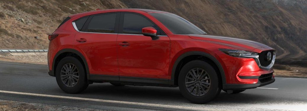 Front passenger angle of a red 2021 Mazda CX-5