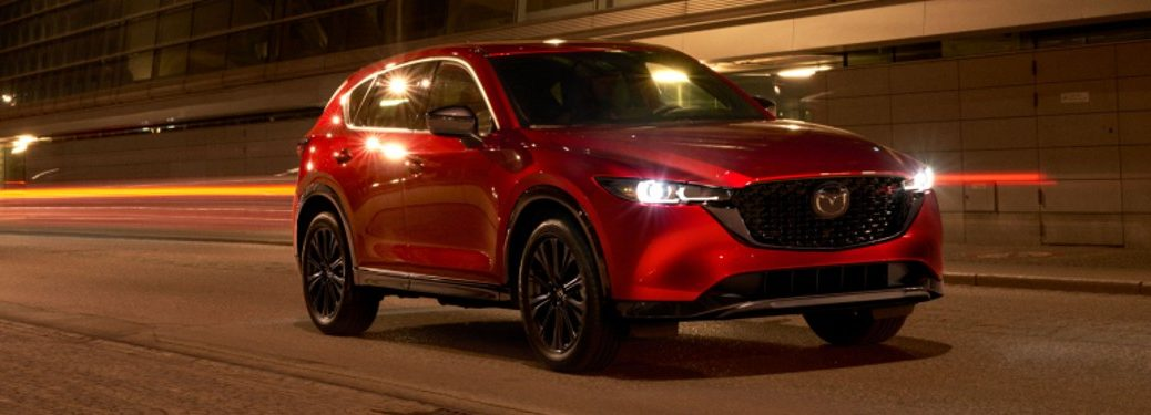 Front passenger angle of a red 2022 Mazda CX-5