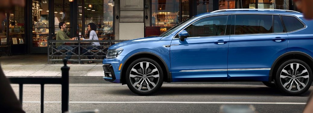 Driver angle of a blue 2020 Volkswagen Tiguan parked on a street