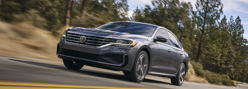 Front driver angle of a grey 2020 Volkswagen Passat driving down a road