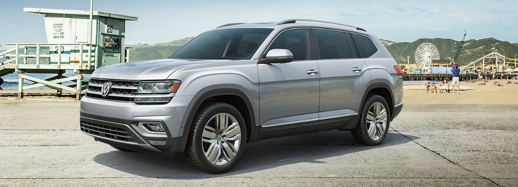 Front driver angle of a silver 2019 Volkswagen Atlas parked by a beach
