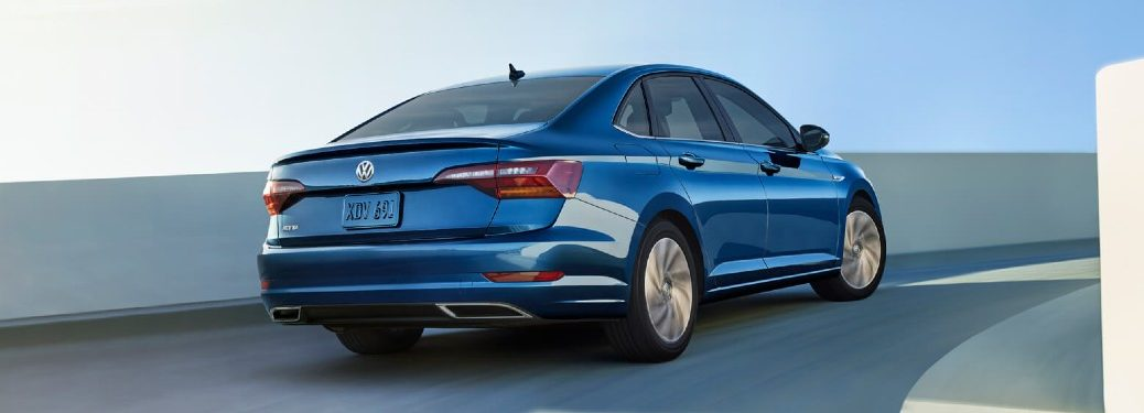 Rear passenger angle of a blue 2019 Volkswagen Jetta