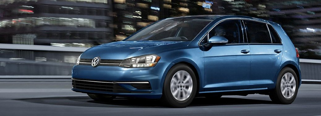 Front driver angle of a blue 2020 Volkswagen Golf driving on a road
