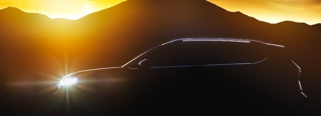 Silhouette of the Volkswagen Taos with mountains and a sunset in the background