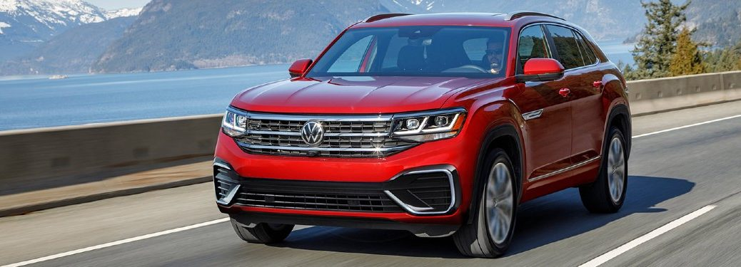 Front driver angle of a red 2021 Volkswagen Atlas Cross Sport driving on a road