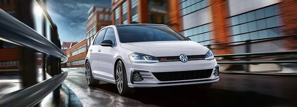 Front passenger angle of a white 2021 Volkswagen Golf GTI
