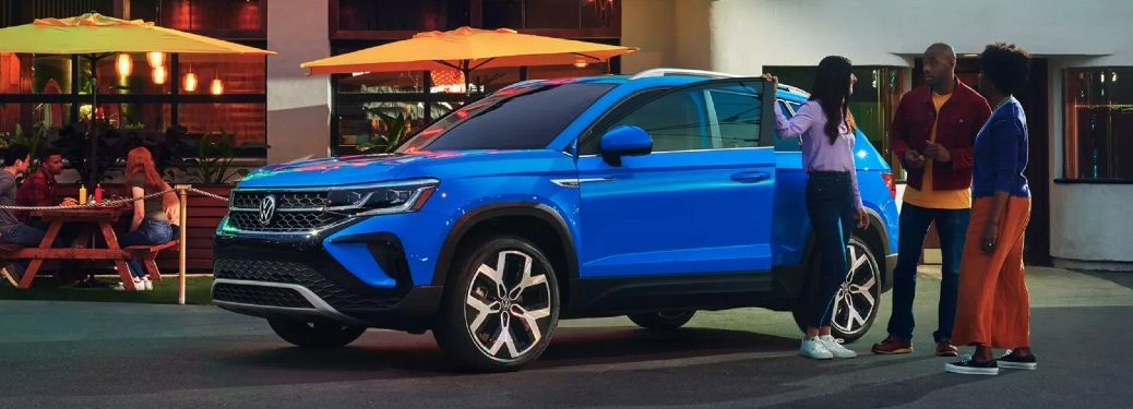 Front driver angle of a blue 2022 Volkswagen Taos