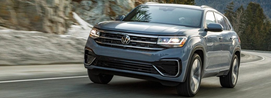 Front driver angle of a blue 2022 Volkswagen Atlas Cross Sport
