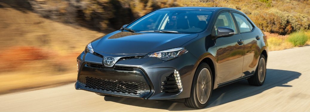 2018 toyota corolla driving on road in pastoral country near lexington ma