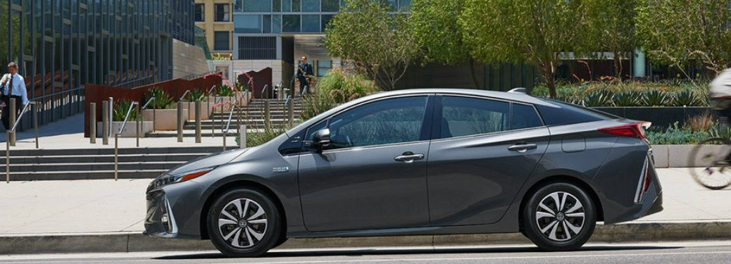 gray Toyota Prius Prime parked on the side of the road near buildings