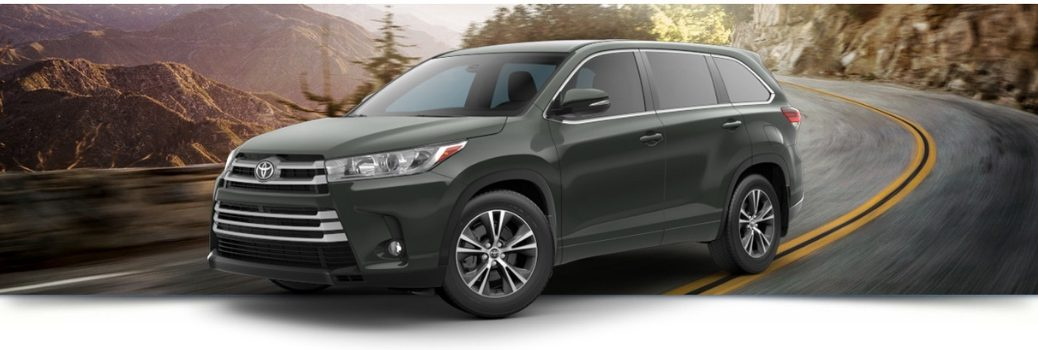 2019 Toyota Highlander driving on the road
