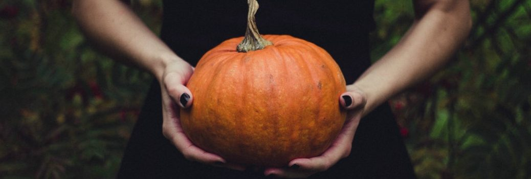 Two hands holding a pumpkin for Halloween