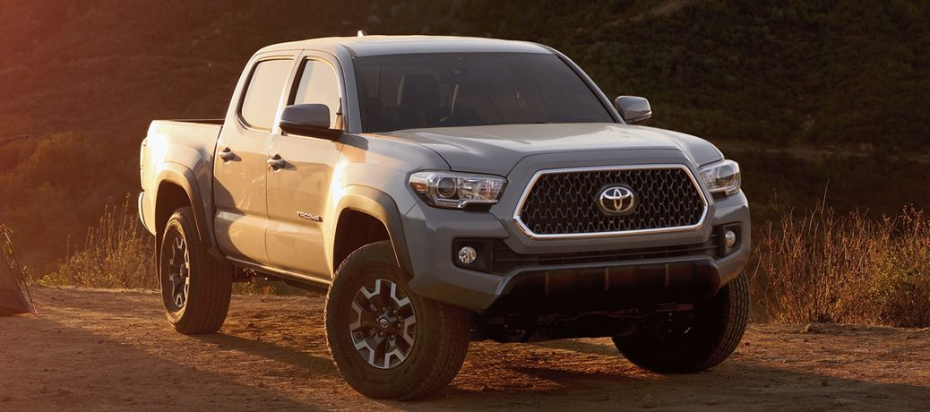 silver 2019 Toyota Tacoma driving on road