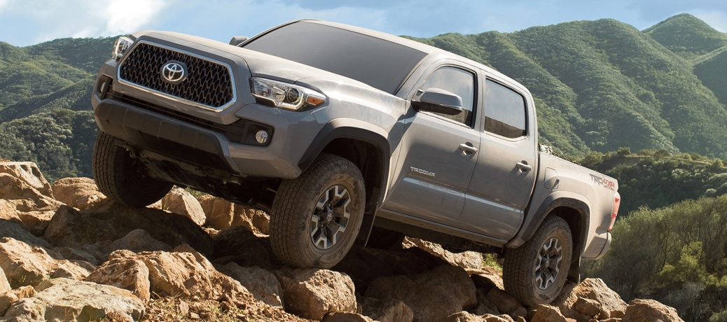 silver 2019 Toyota Tacoma on rocks