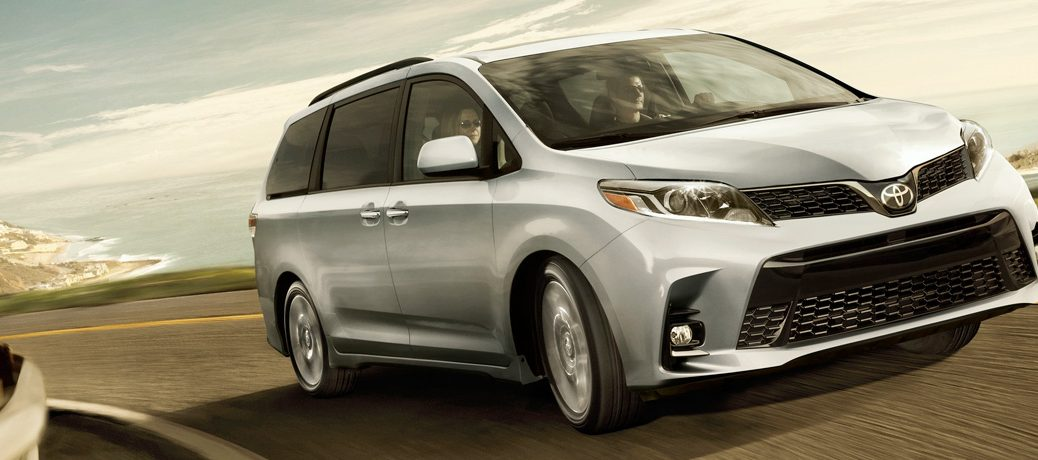 silver 2019 Toyota Sienna driving on road
