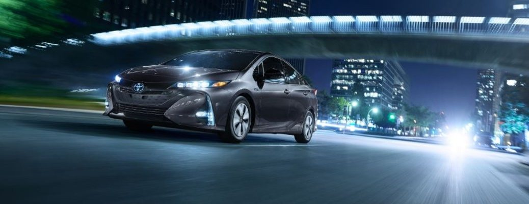 silver prius prime under a bridge