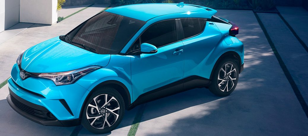 blue toyota c-hr on a road