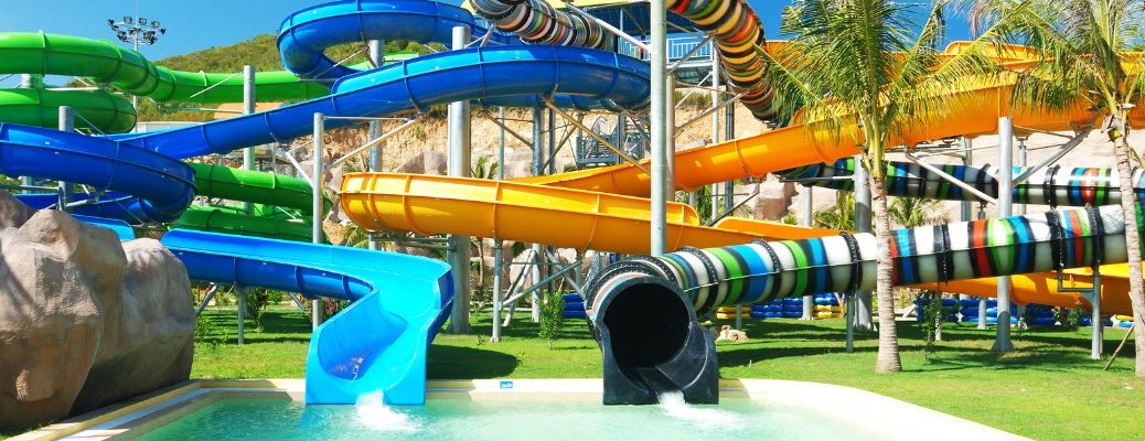 two water slides leading into a pool