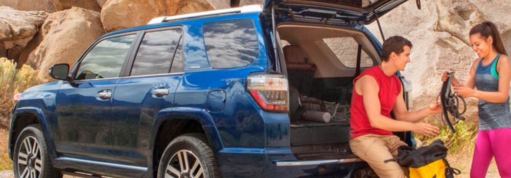 blue 2019 Toyota 4Runner with couple