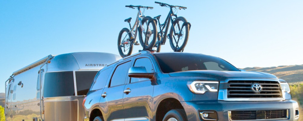 2019 Toyota Sequoia towing an airstream and holding bikes