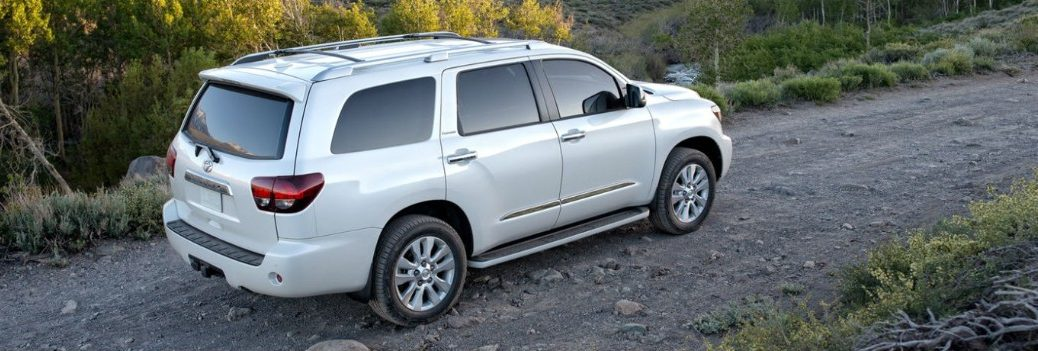 white 2019 Toyota Sequoia driving down the road