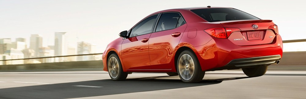 red 2019 Toyota Corolla driving down the road