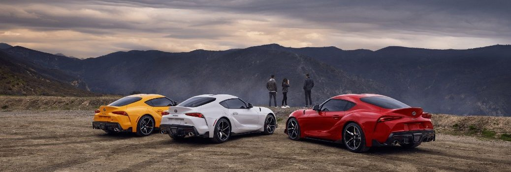 three 2020 Toyota Supra GR cars parked on moutain