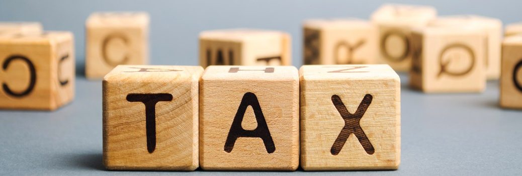 wooden blocks spelling out tax