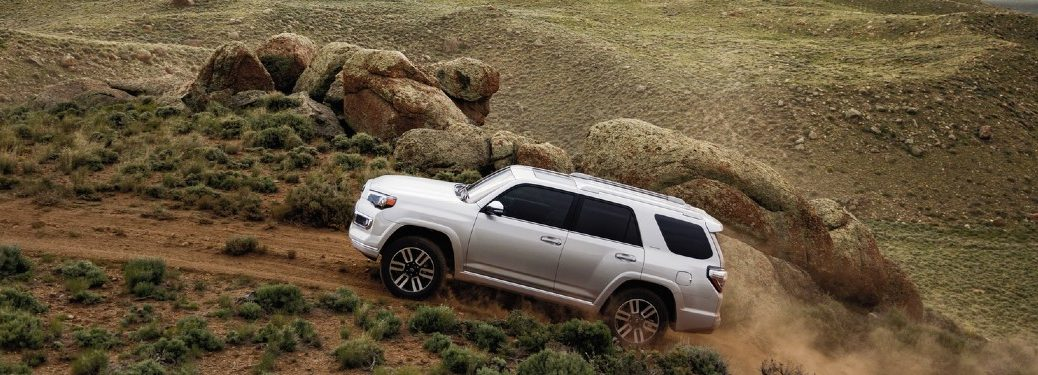 2020 Toyota 4Runner driving up dirt pile