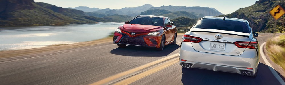 two Toyota Camry models passing each other