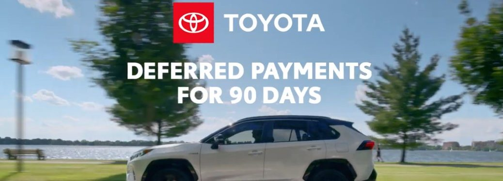 "Toyota vehicle driving down road with text overlaying saying ""deferred payments for 90 days"""