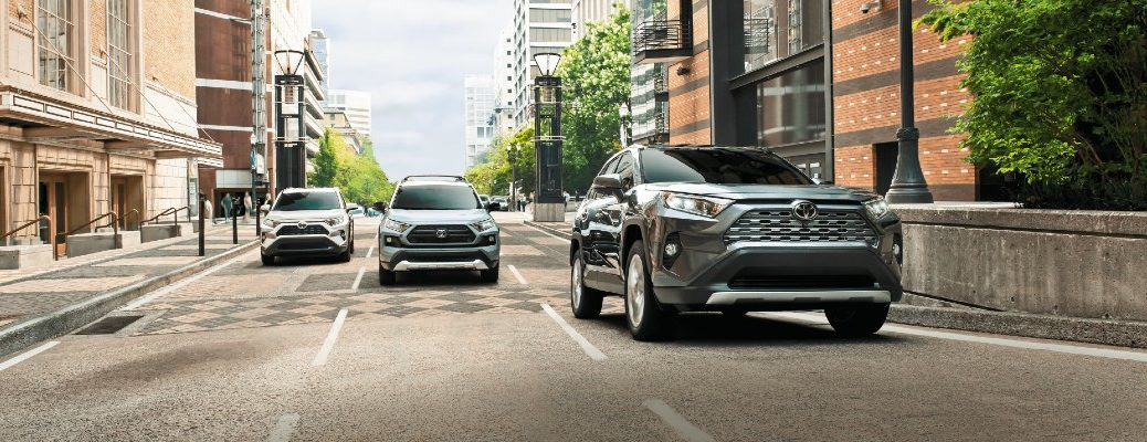 A photo of three 2020 Toyota RAV4 models on the road.