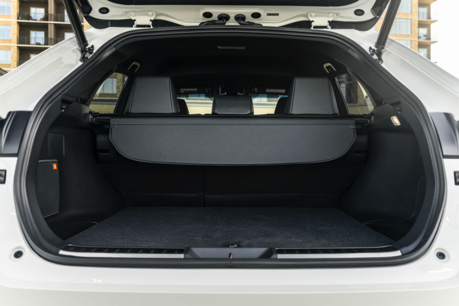 A photo of the cargo area with the rear seats up in the 2021 Toyota Venza.