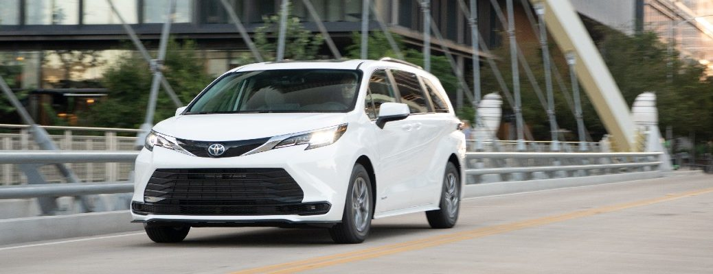 A head-on photo of the 2021 Toyota Sienna crossing a bridge.