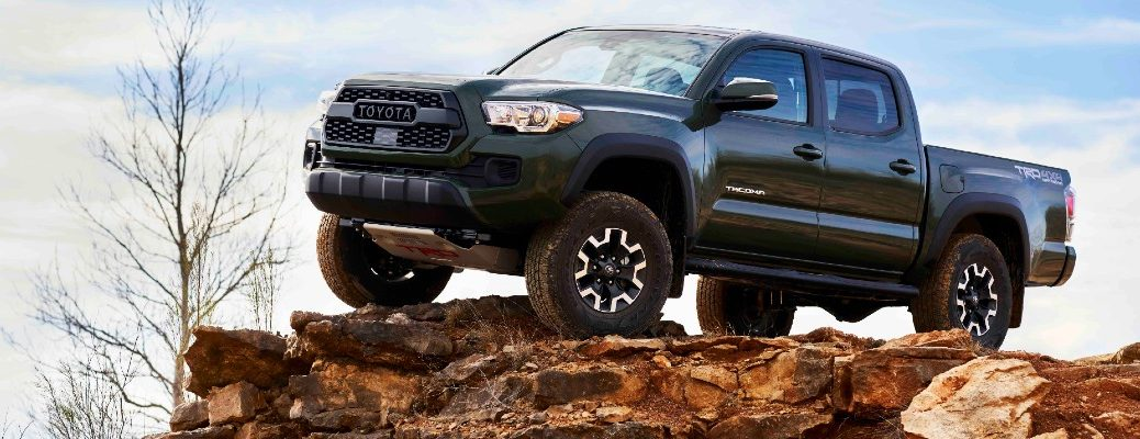 A photo of the 2021 Toyota Tacoma parked on a rocky outcropping.