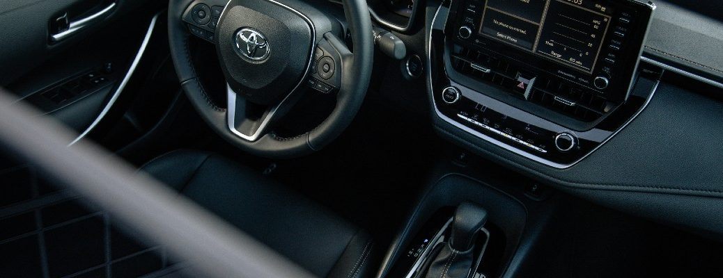 An overhead look inside the driver's cockpit of the 2021 Toyota Corolla.
