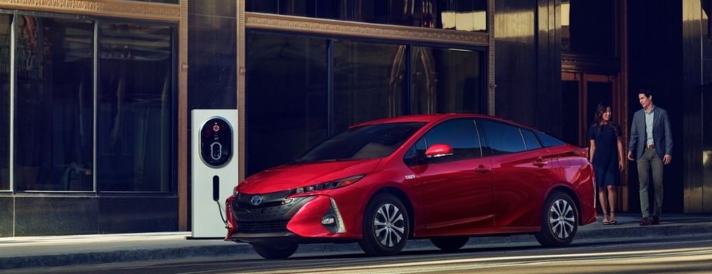 2021 Toyota Prius Prime Red near a Charging Station