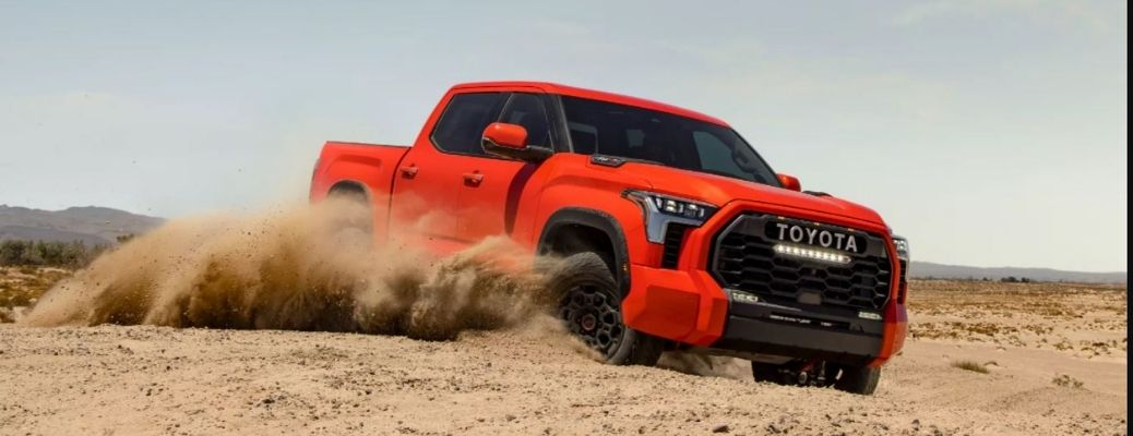 A red 2022 Toyota Tundra in the desert