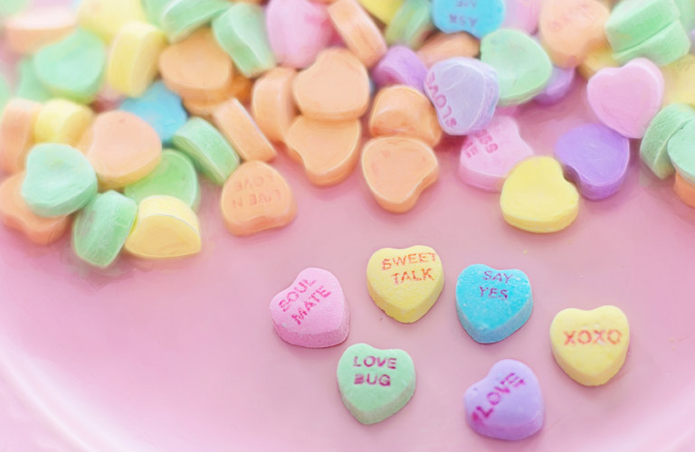 heart candies on a pink table