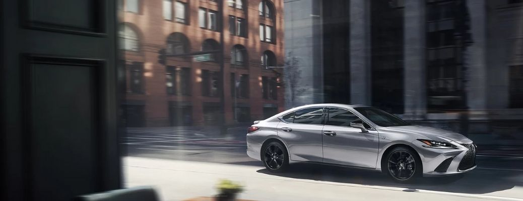Side view of a silver 2022 Lexus ES cruising on a road. WHat are the engine specifications?