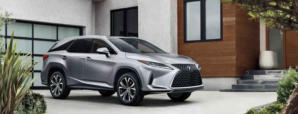Sideview of a 2022 Lexus RX parked in front of a house. What are the engine specifications?