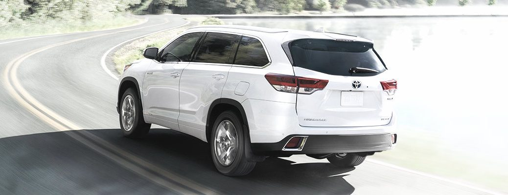 White 2019 Toyota Highlander driving in the winter