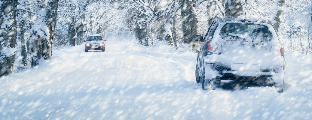 Two cars on a snowy road