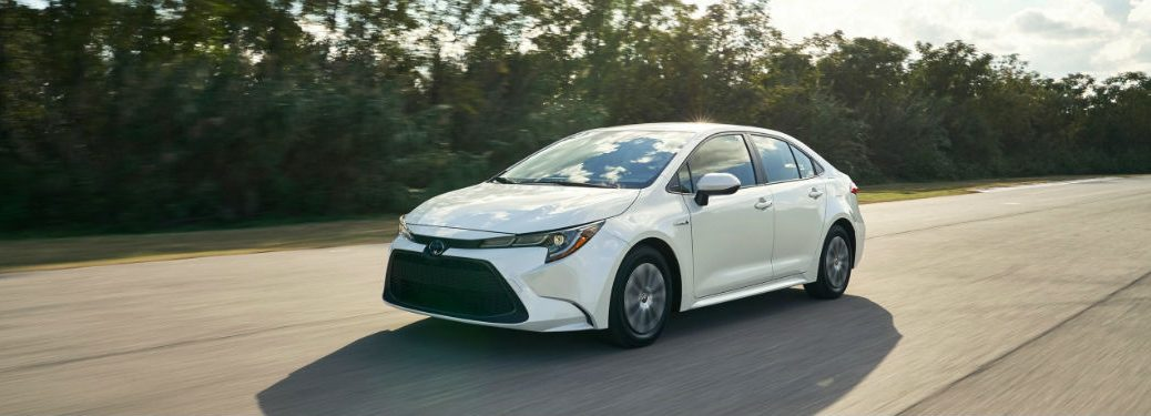 2020 Toyota Corolla white exterior front fascia driver side driving on street