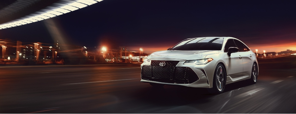 2020 Toyota Avalon wind chill pearl driving through city at night