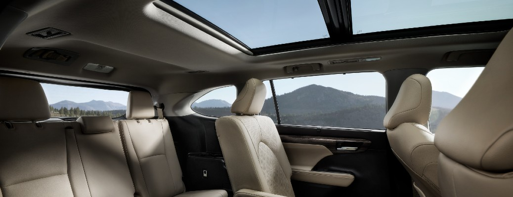 2020 Toyota Highlander interior showing panoramic moonroof and beige leather seats